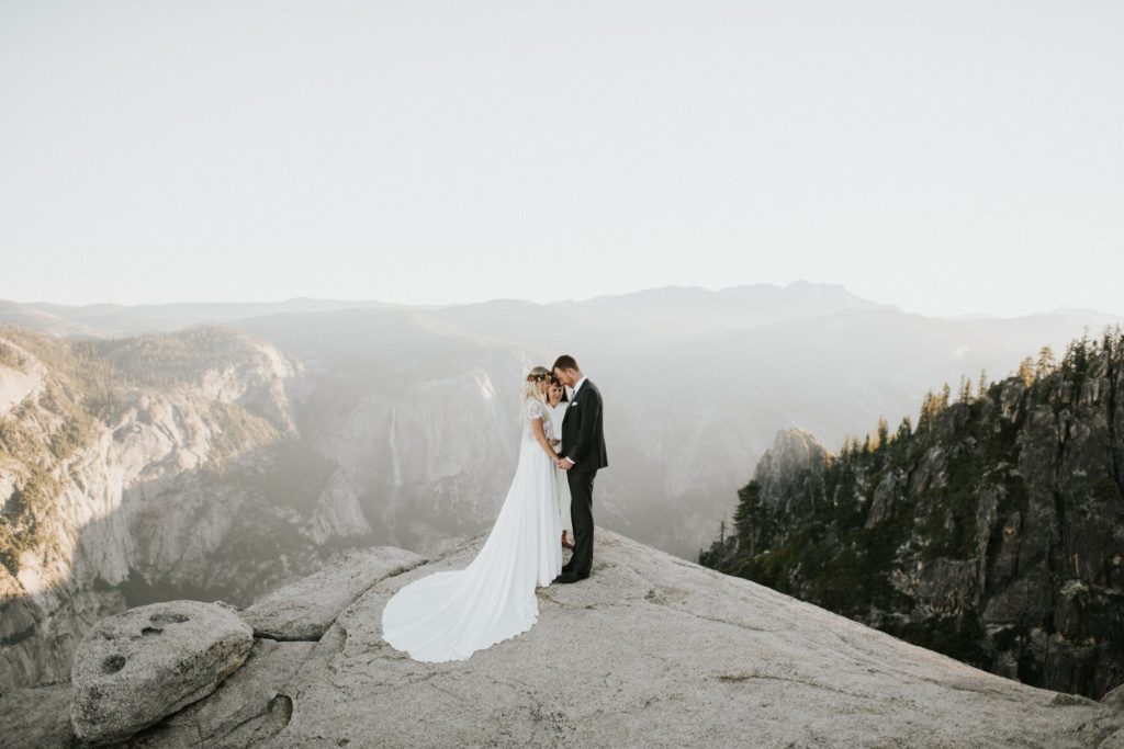 This couple is sharing an emotional moment during their Taft Point Yosemite Elopement