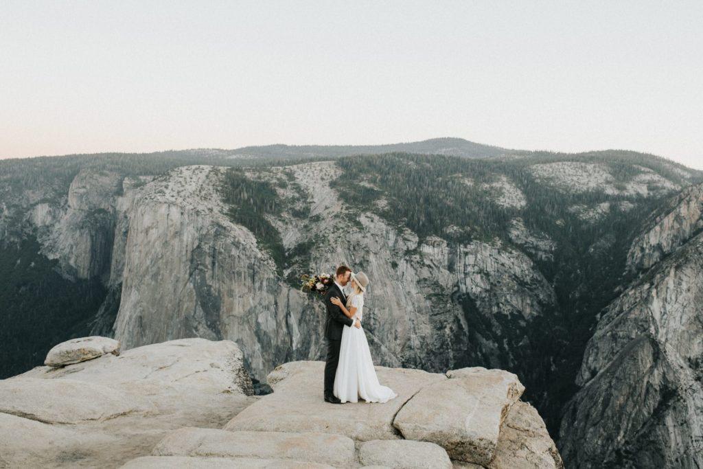 Bride and groom kissing at yosemite national park