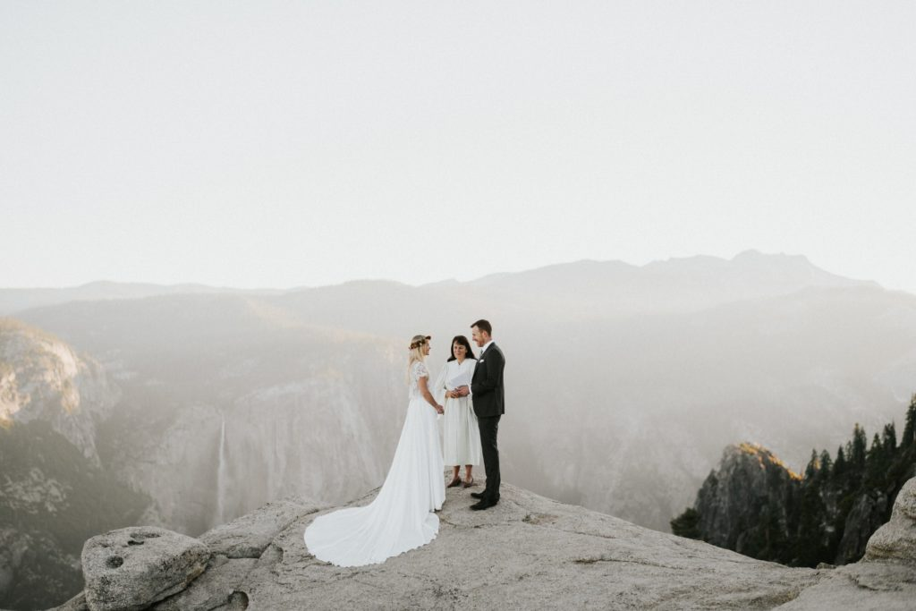 Bride and groom holding hands at their Yosemite national park elopement