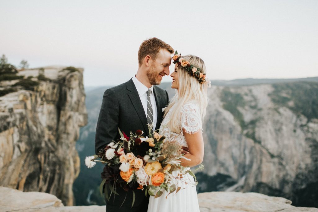 Bride and groom looking at each other at yosemite national park elopement