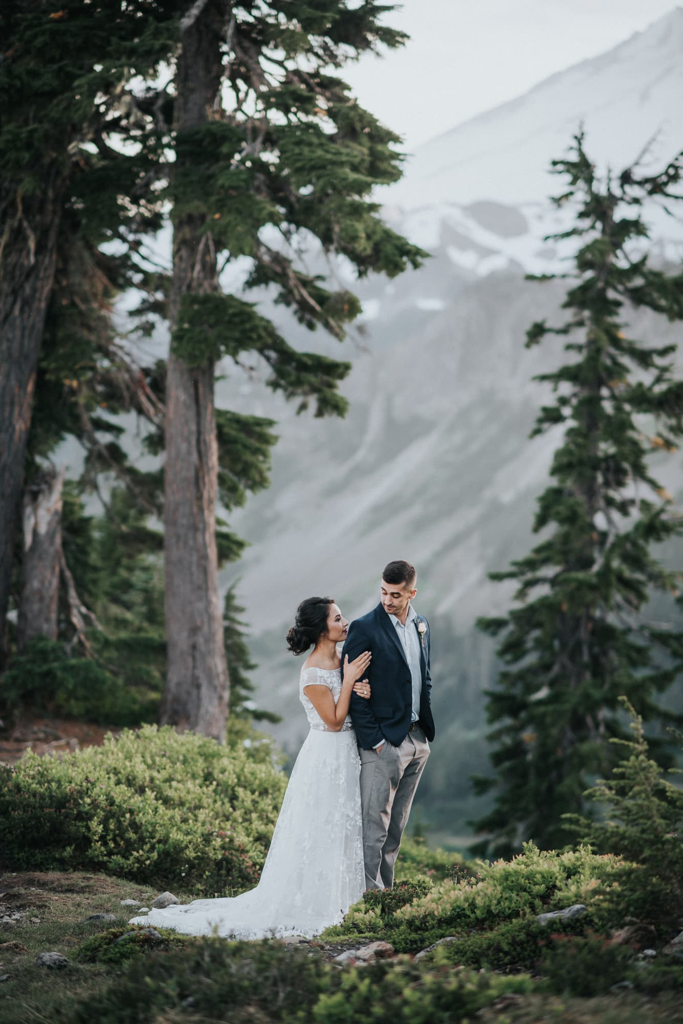 bride and groom in the trees at artist point