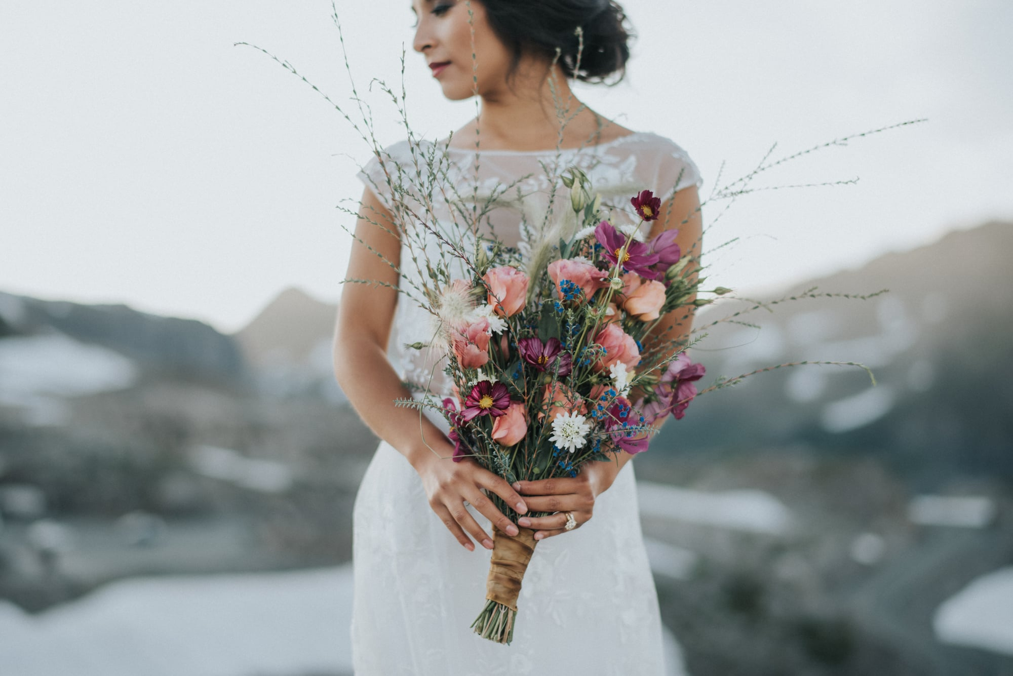 bride holding bouquet during artist point styled photoshoot