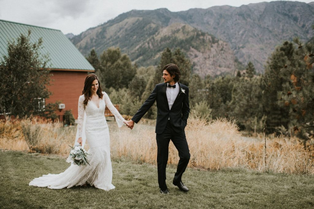 groom leading bride at leavenworth wedding
