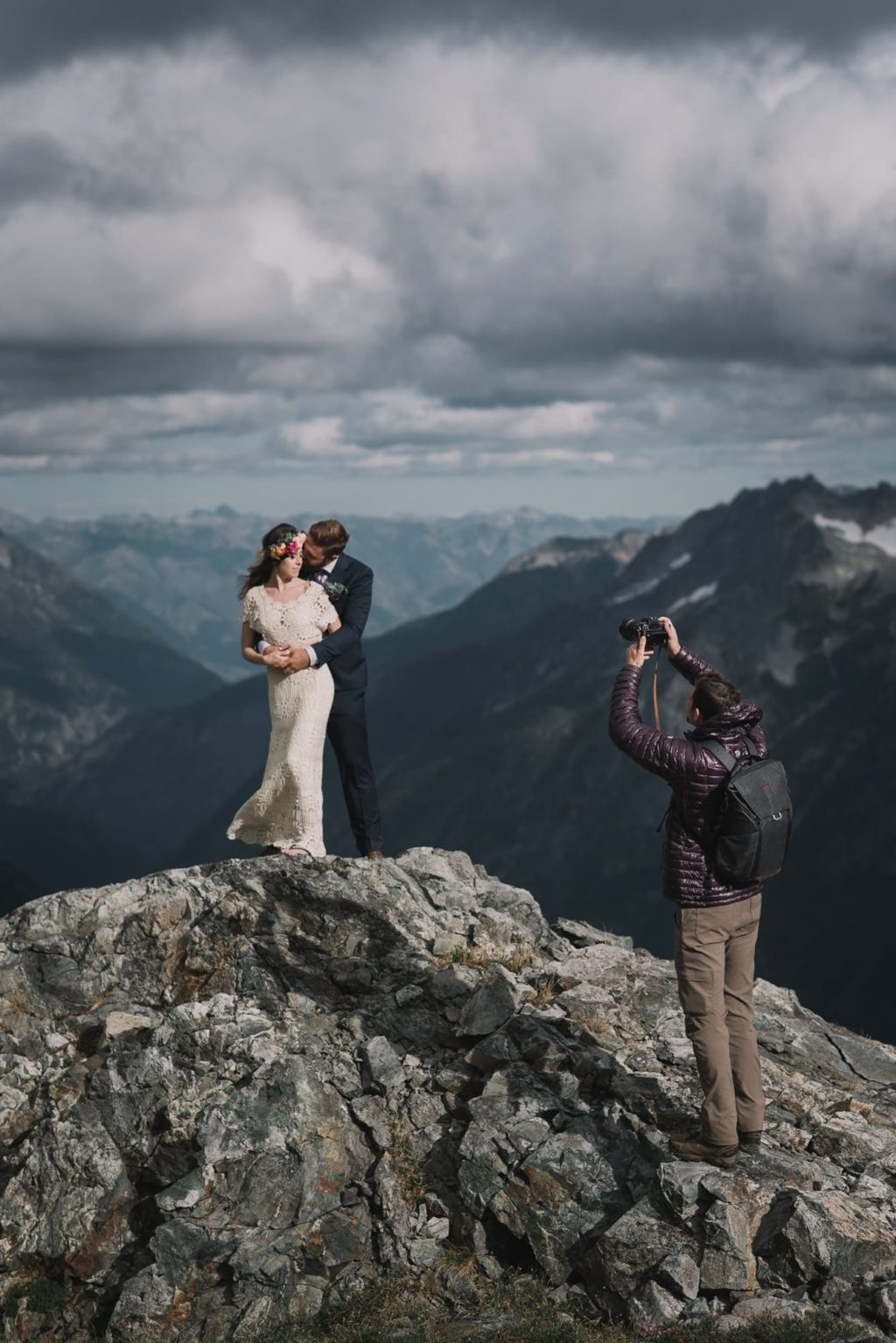 photographer taking a photo of bride and groom