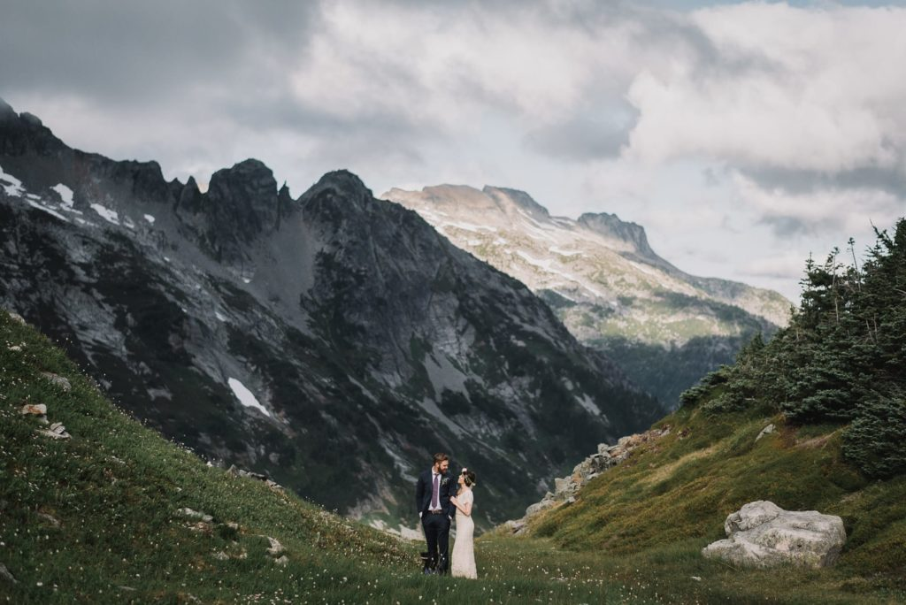 bride and groom looking at each other in a valley