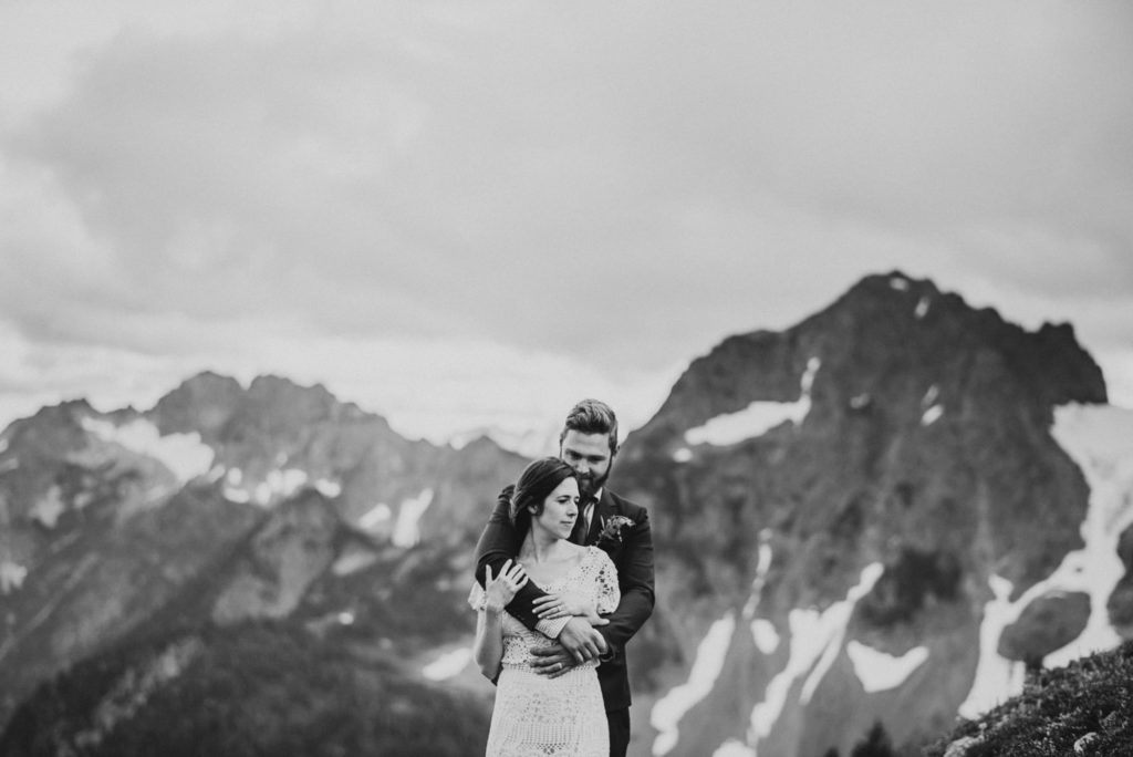 black and white of groom holding bride