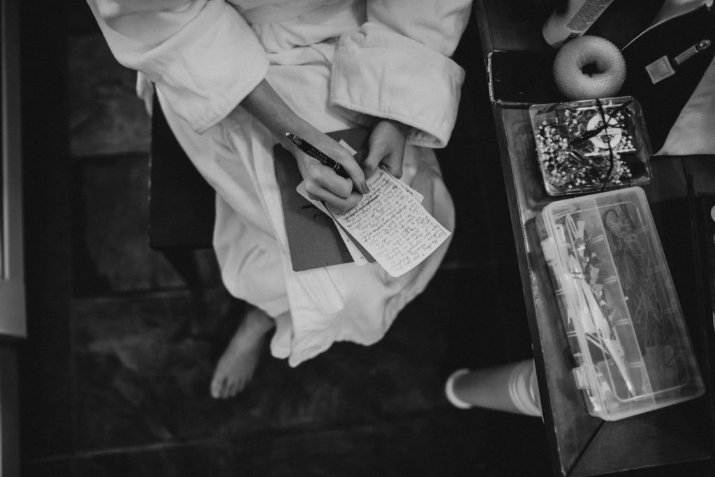 Bride writing her vows in black and white