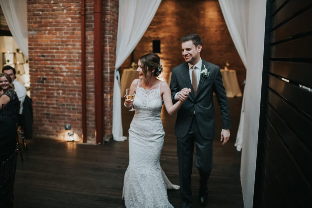 Bride and groom entering their reception at Axis Pioneer square wedding