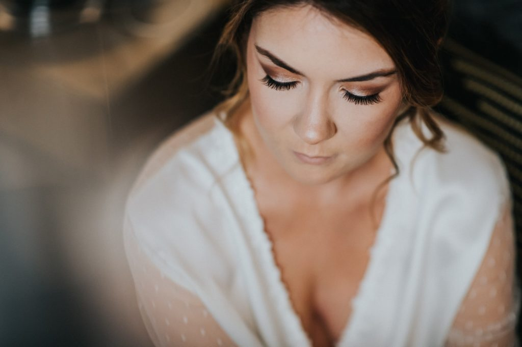Overhead shot of bride's makeup at her Axis Pioneer Square wedding