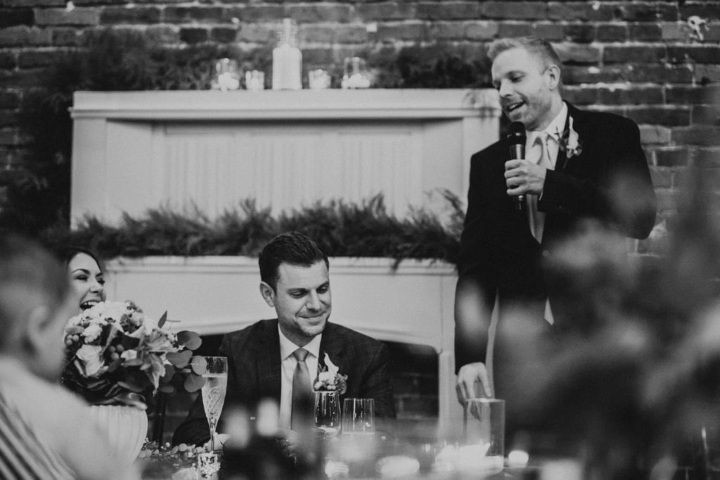 black and white of best man giving his speech