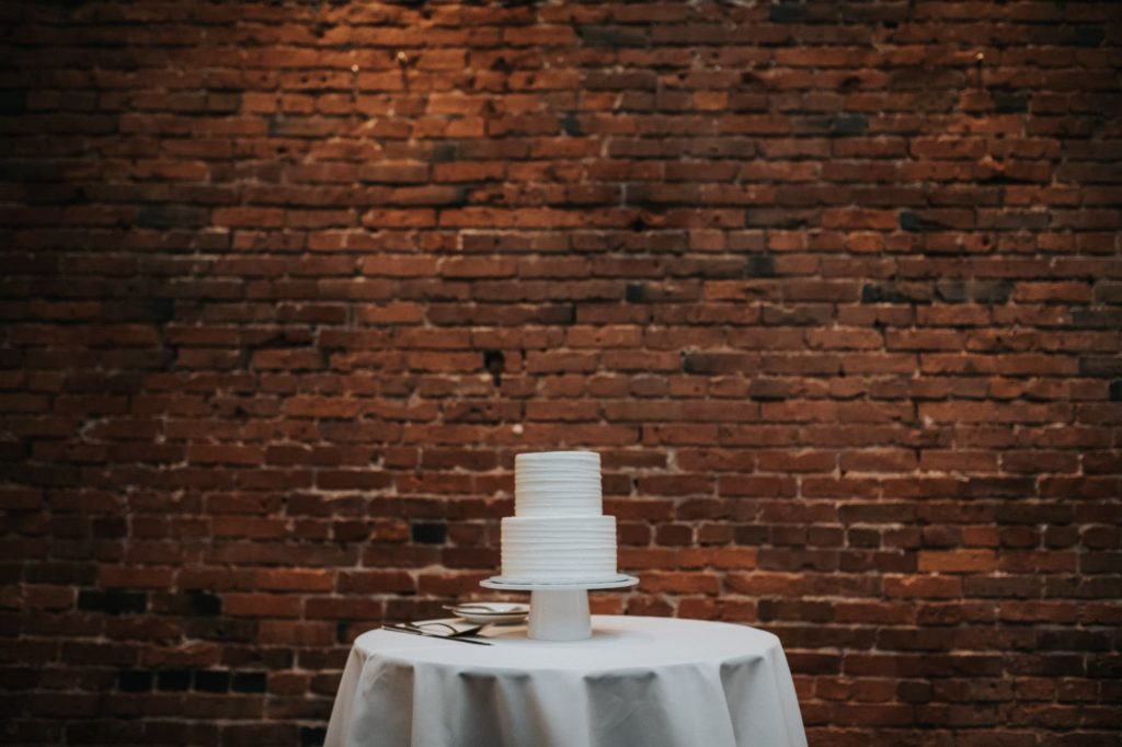 cake against a brick wall