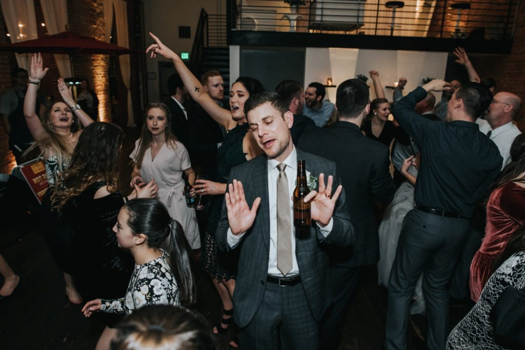 groom dancing at his reception