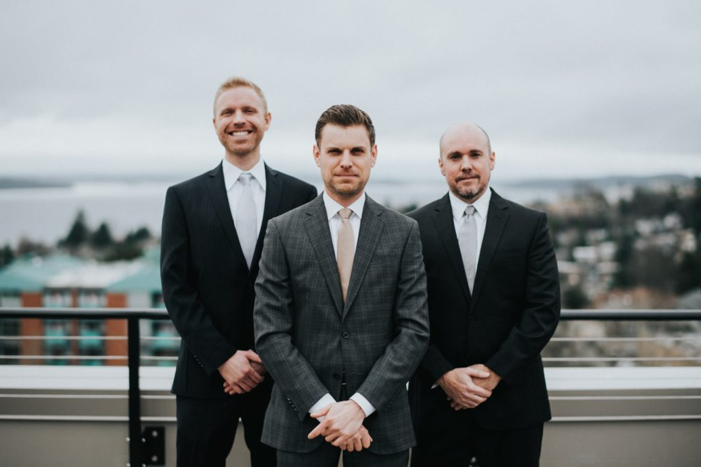 Groom with groomsmen on rooftop