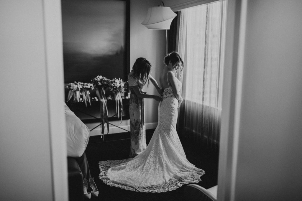 Black and white image of bride getting ready