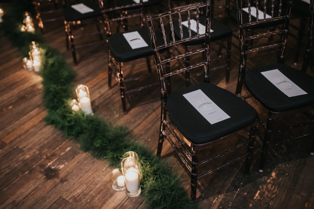 shot of chairs and greenery at ceremony