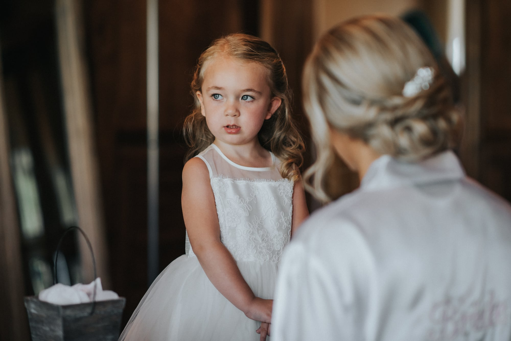 bride helping daughter get ready for wedding