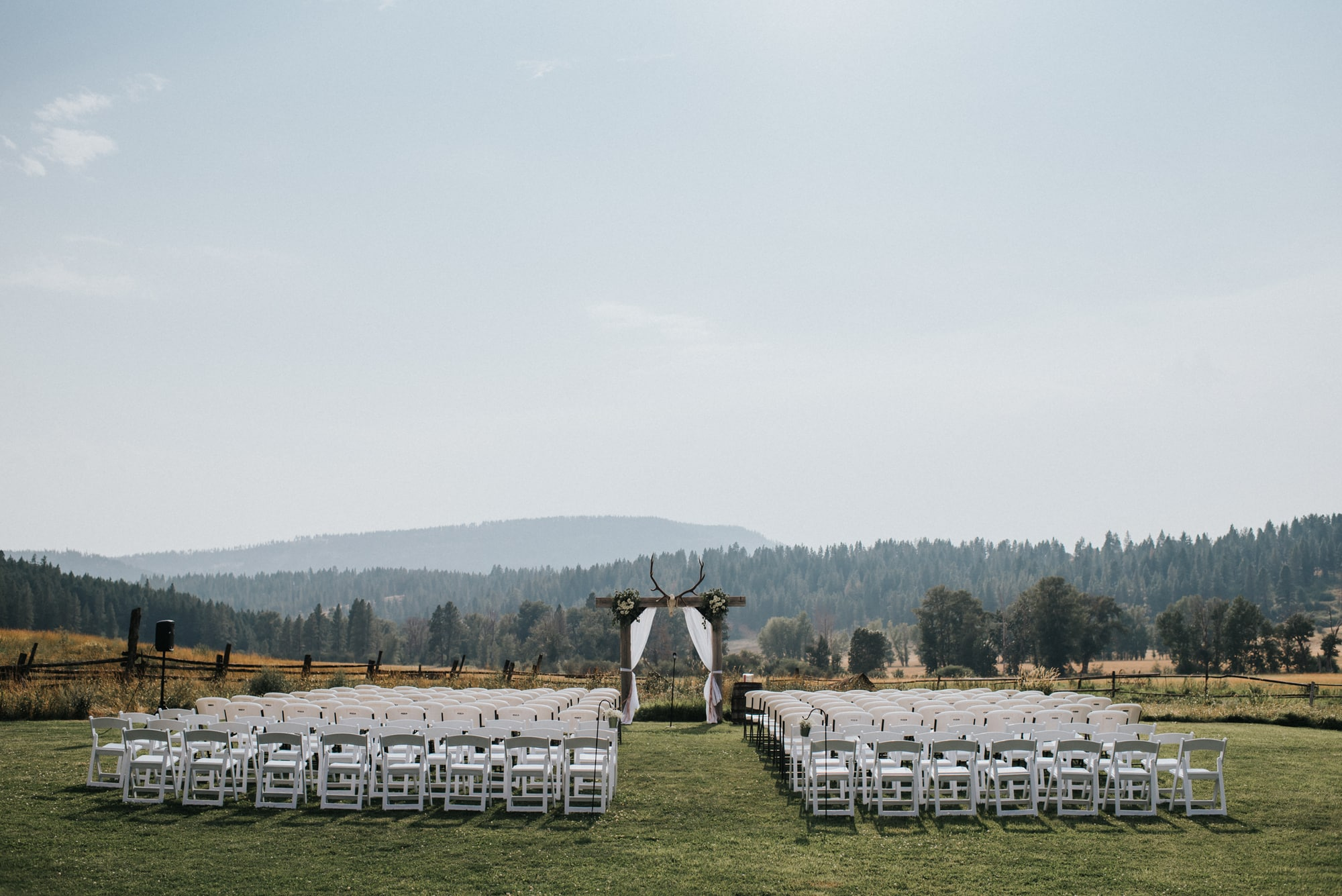 outdoor wedding ceremony setup at the cattle barn
