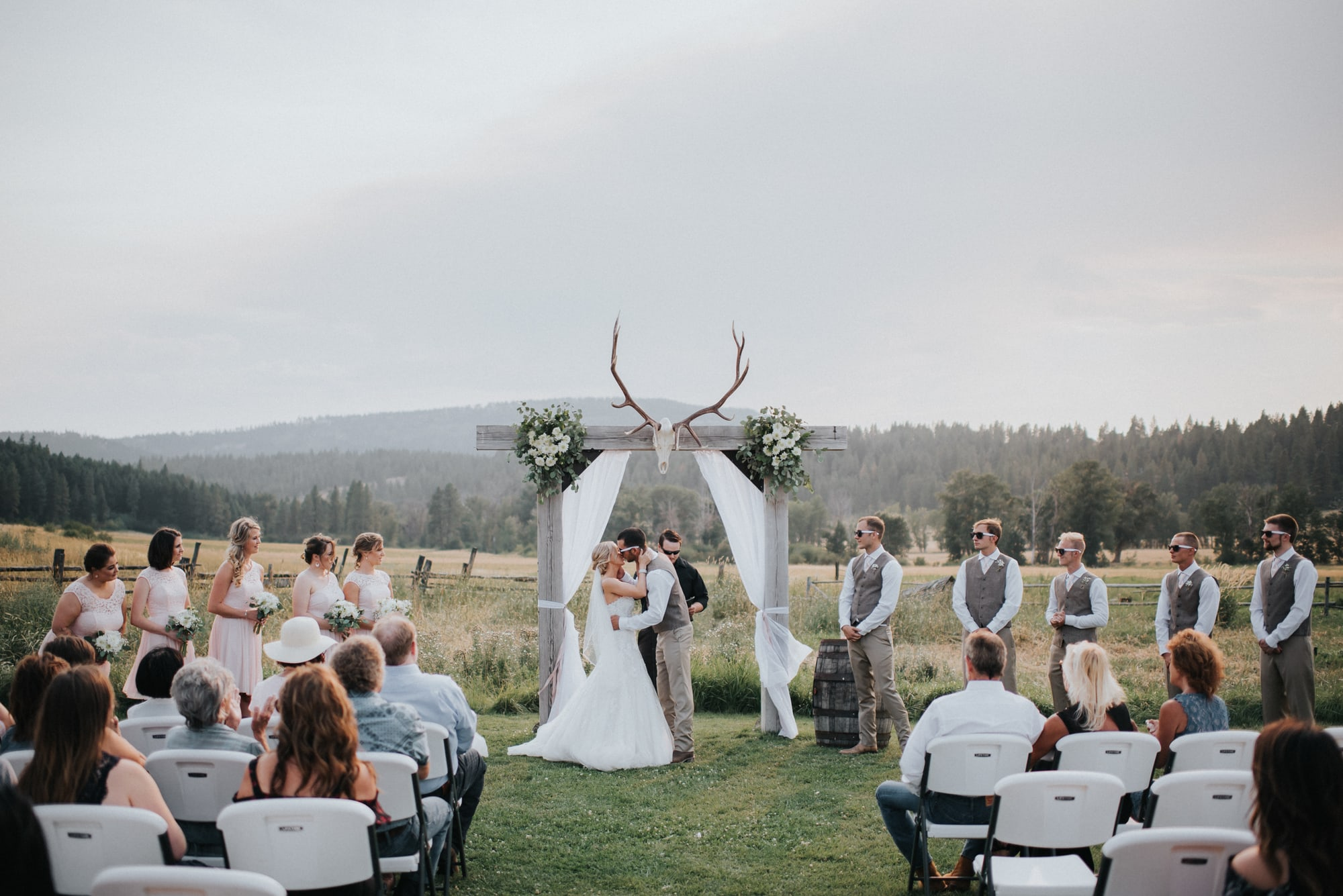 bride and groom first kiss at the cattle barn