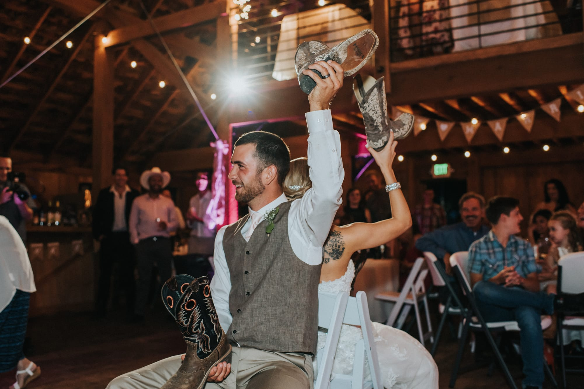 bride and groom play the shoe game
