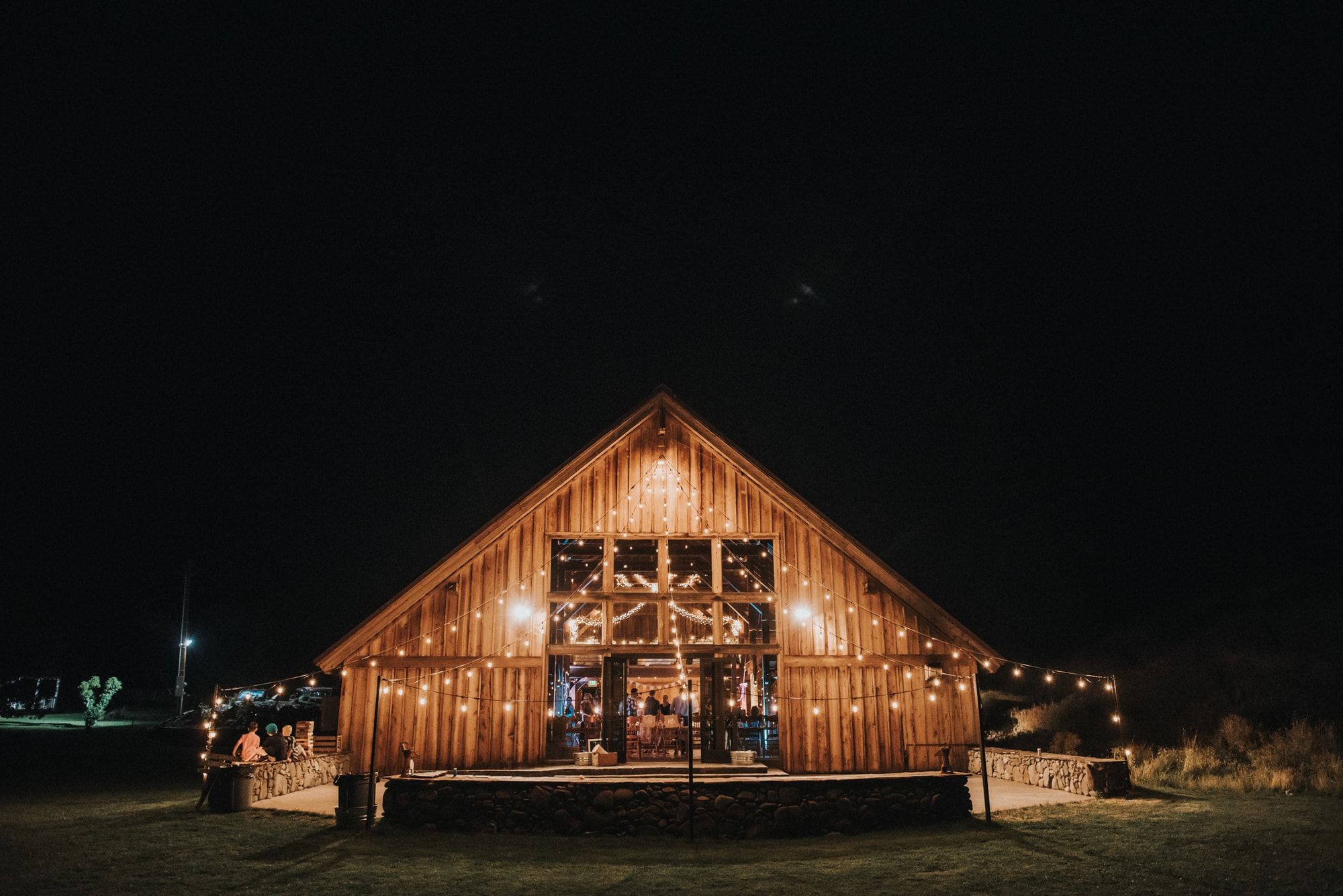 back view of the cattle barn lit up at night