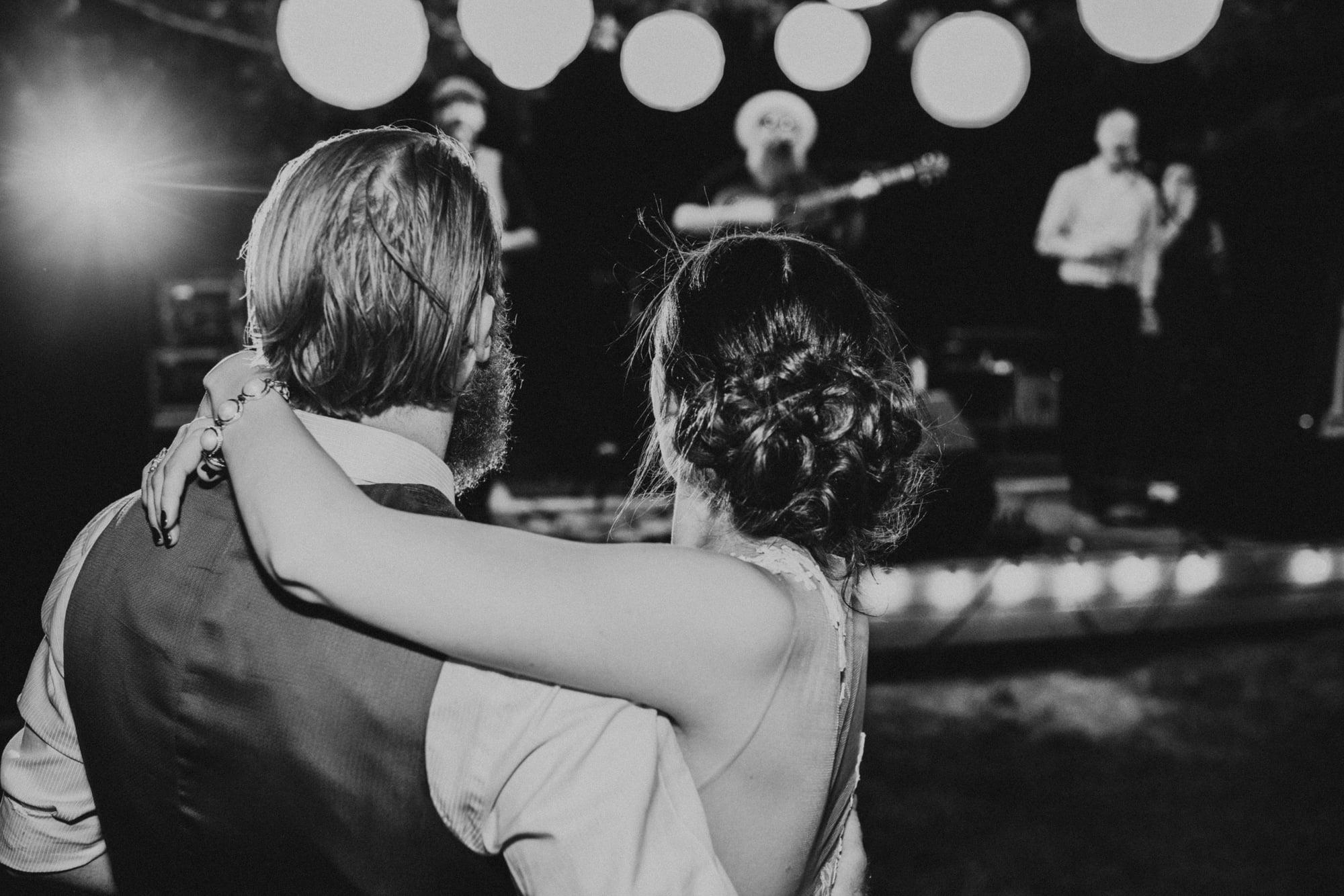 bride and groom dance together at backyard yakima wedding