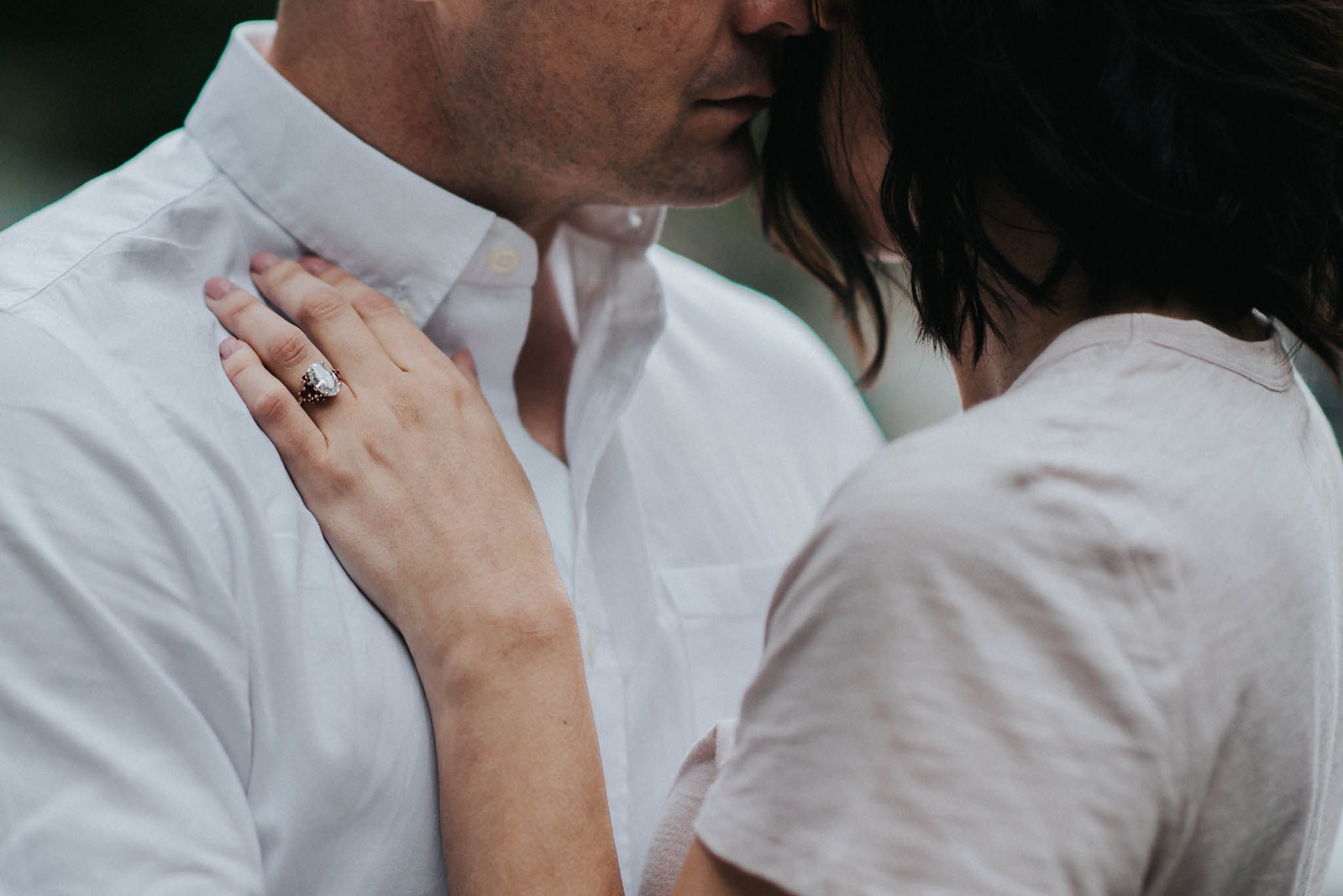 Here is a photo of a gorgeous engagement ring during their engagement photo session