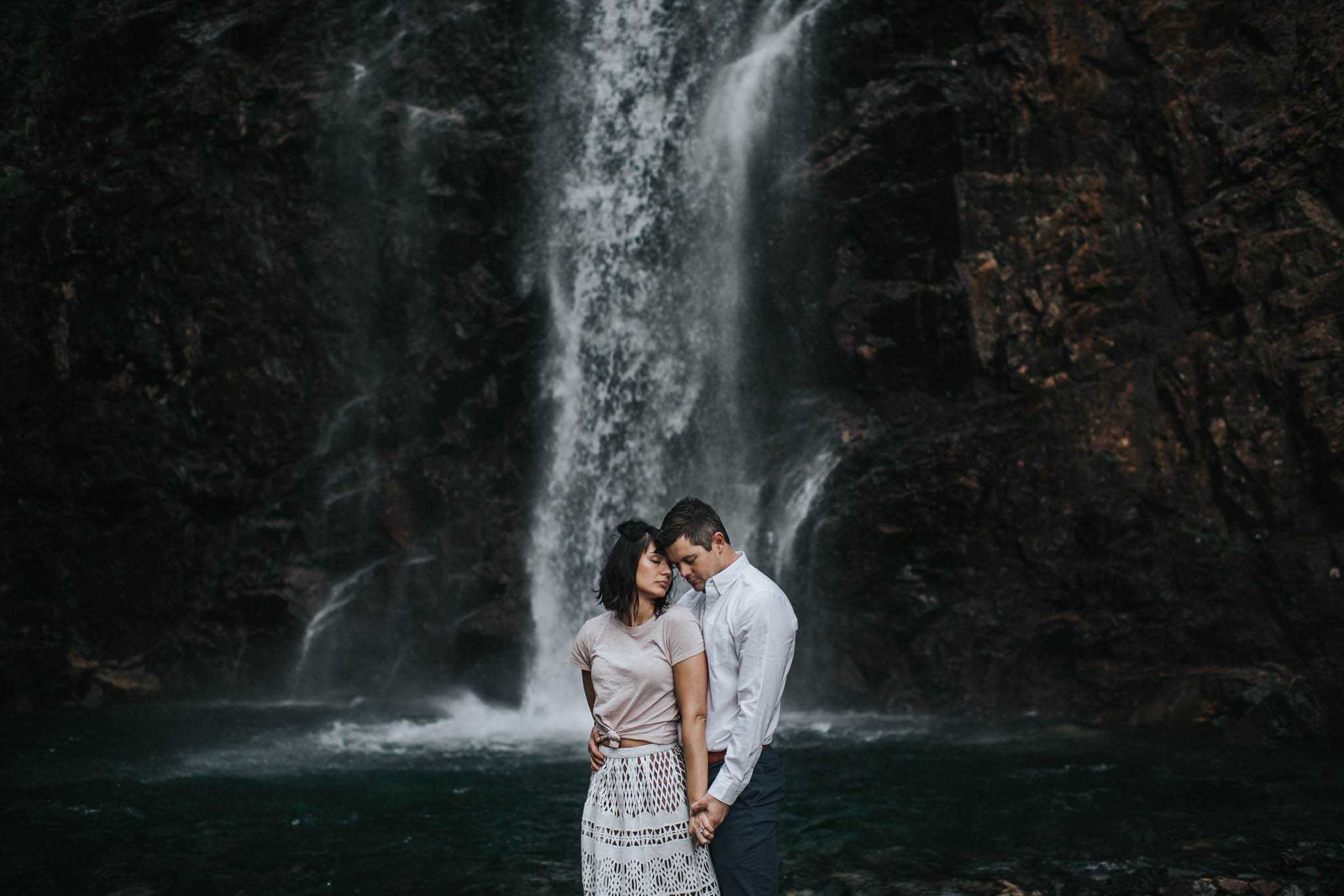 This is a photo of an adventurous couple during their Franklin Falls Engagement Session