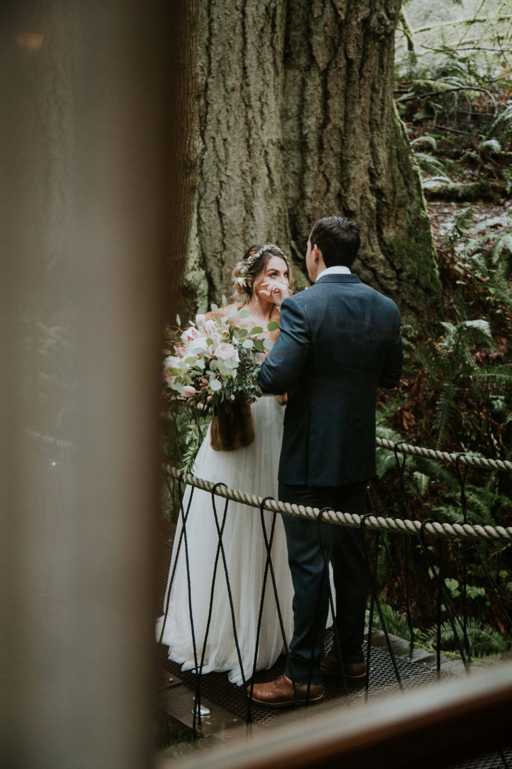 Bride emotional after her first look with groom