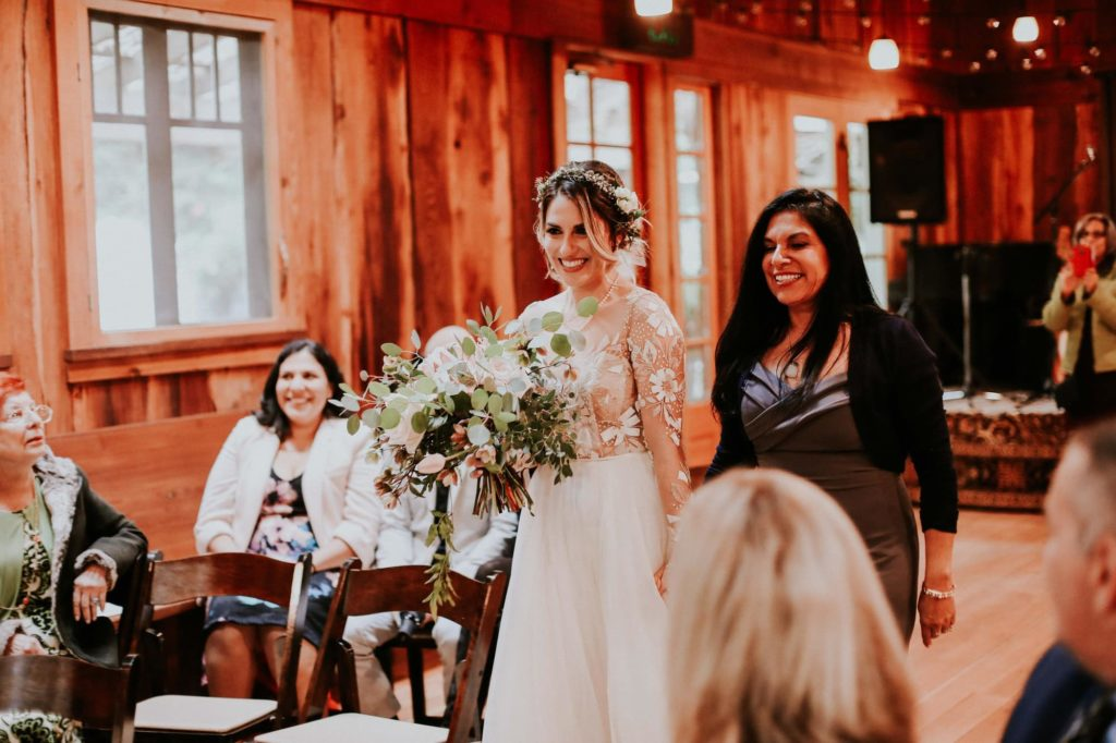 mother walking bride down the aisle