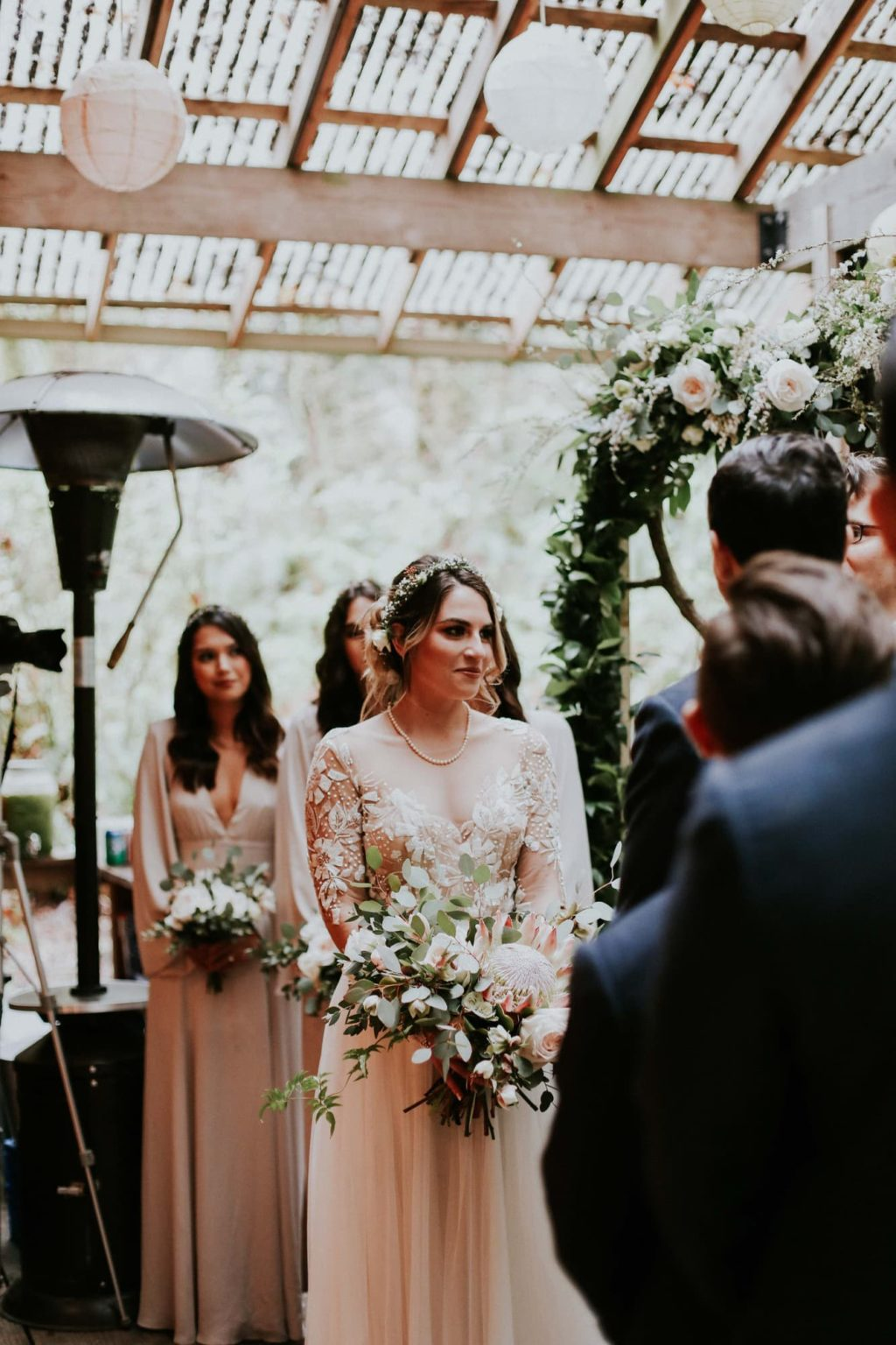 bride looking at officiant at her ceremony