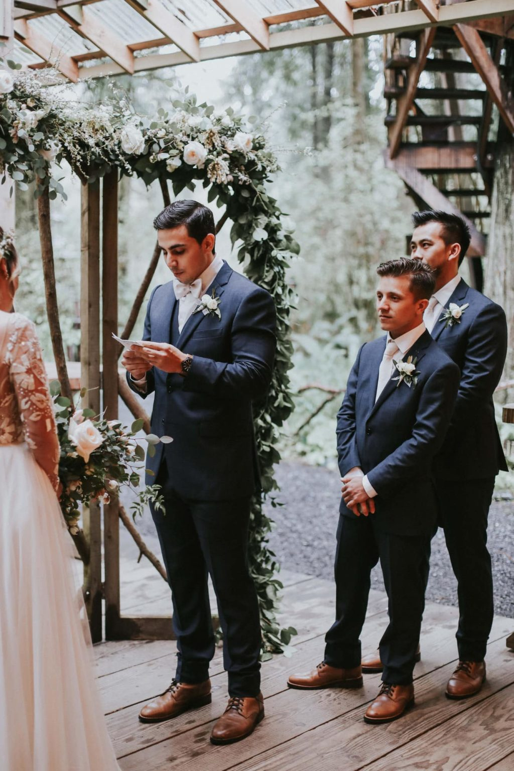 groom reading his vows at his ceremony