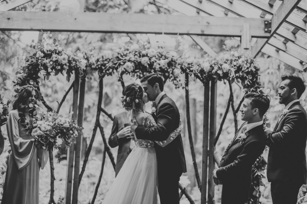bride and groom kissing at their ceremony
