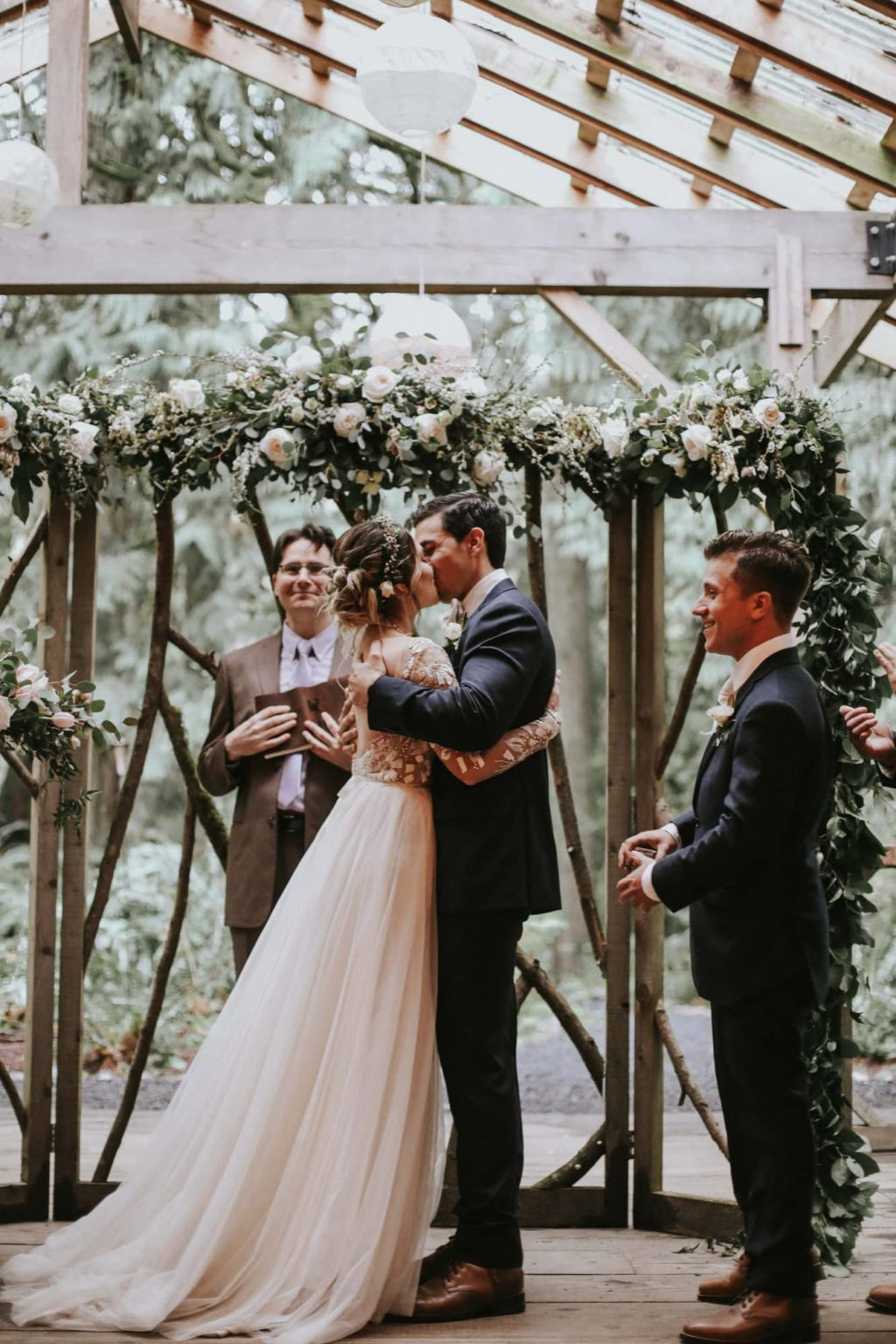 bride and groom kissing at their treehouse point wedding