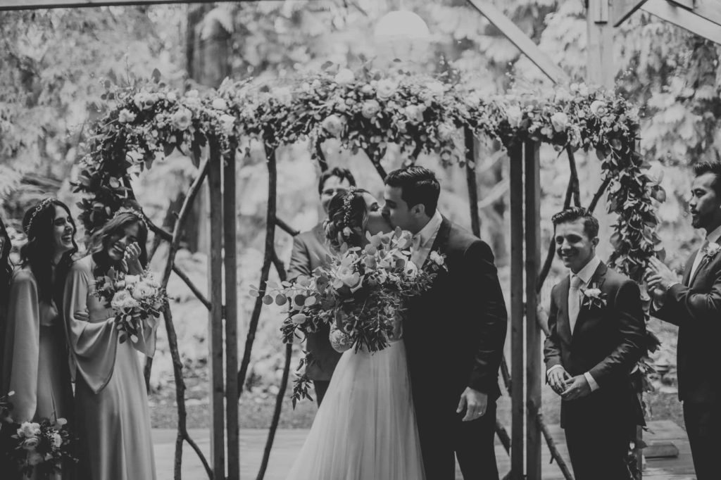 bride and groom kissing at their wedding