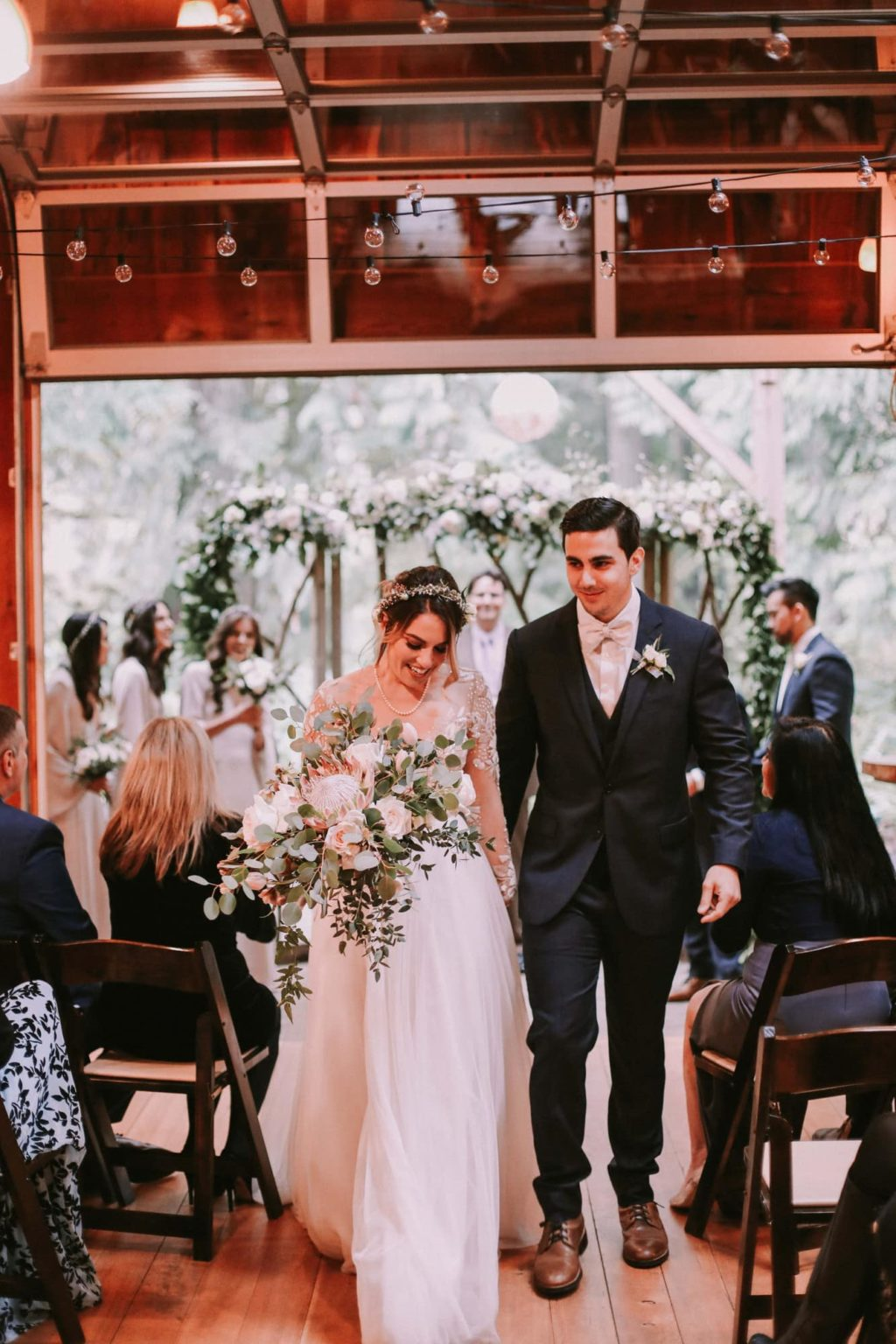 bride and groom exiting their treehouse point wedding ceremony