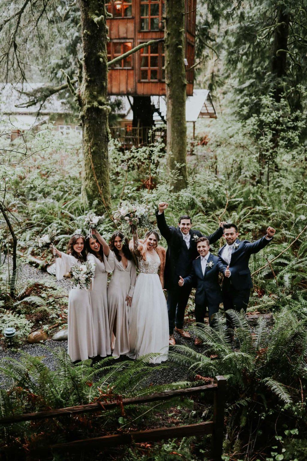 bridal party cheering at the camera