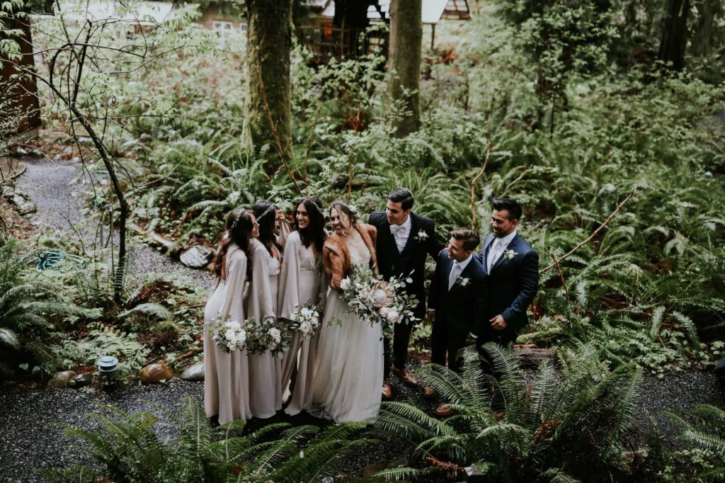 bridal party looking at each other and laughing