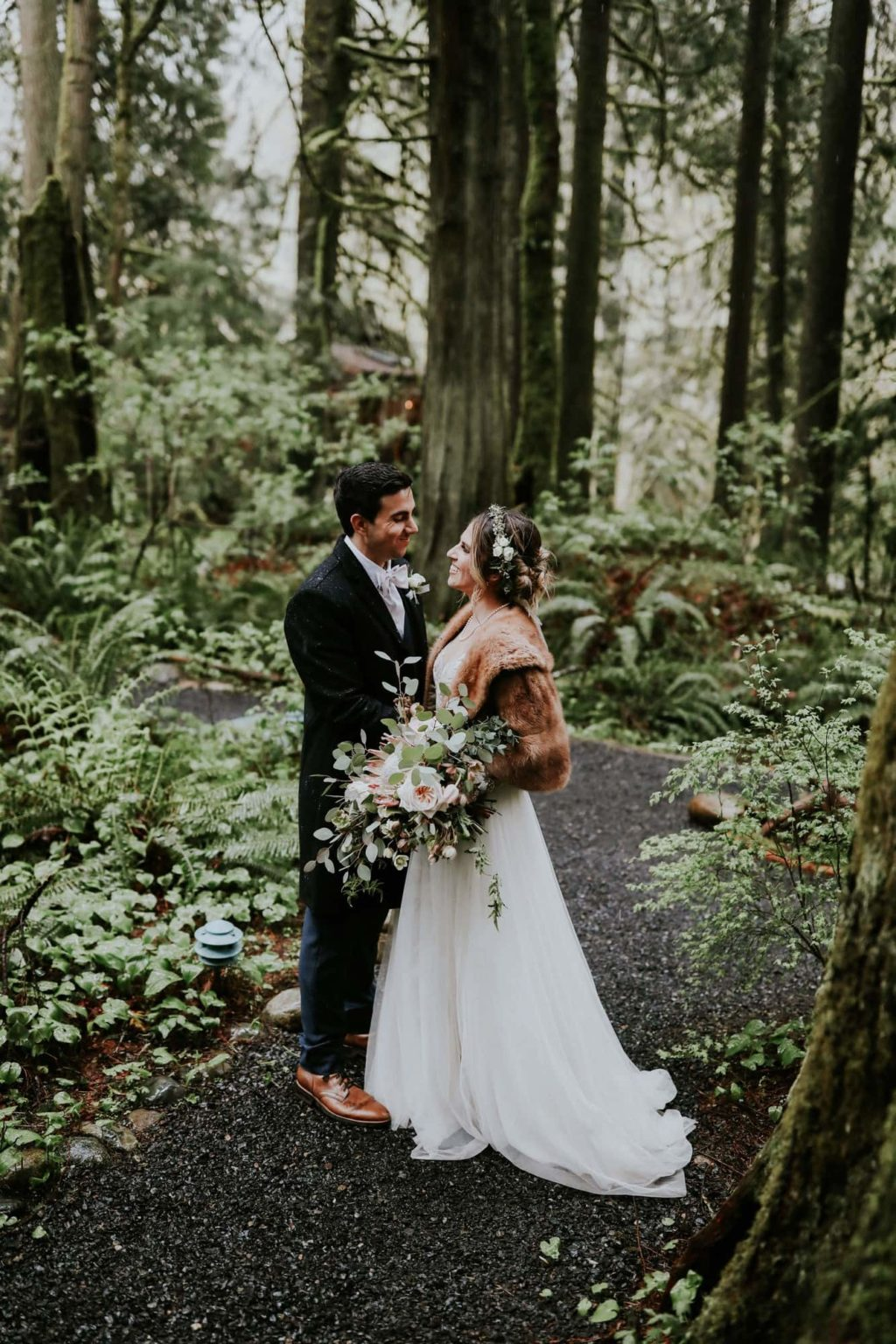 bride and groom looking at each other at their treehouse point wedding