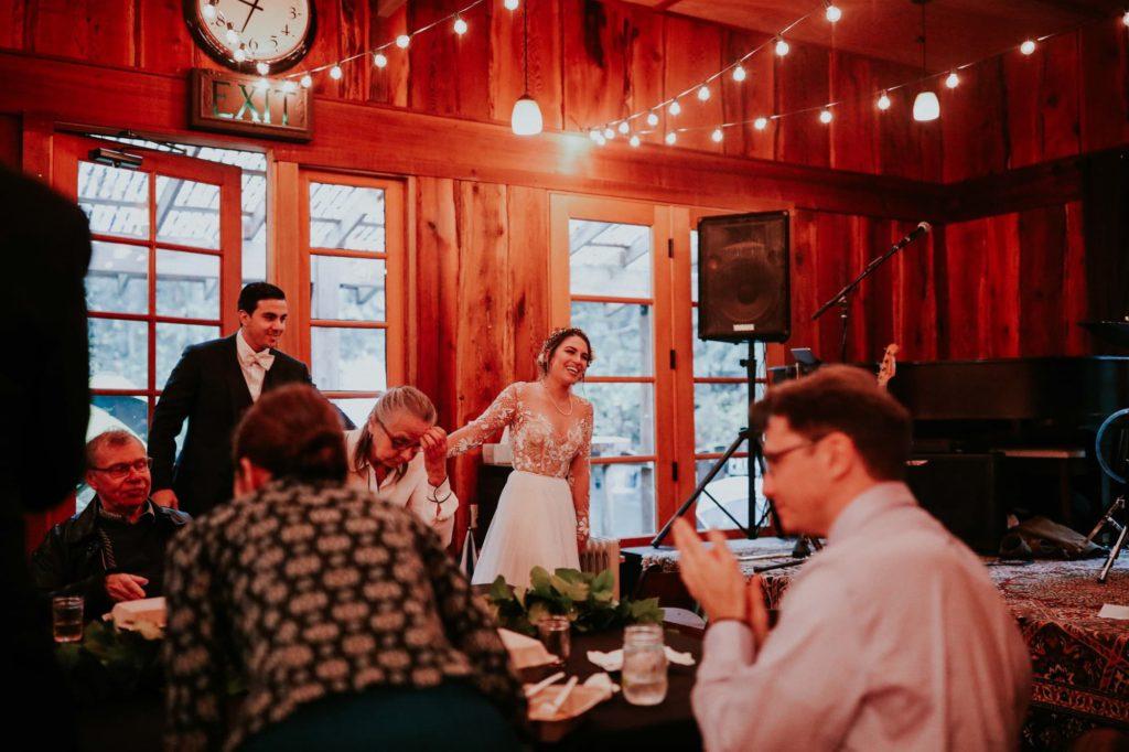 bride and groom entering their reception