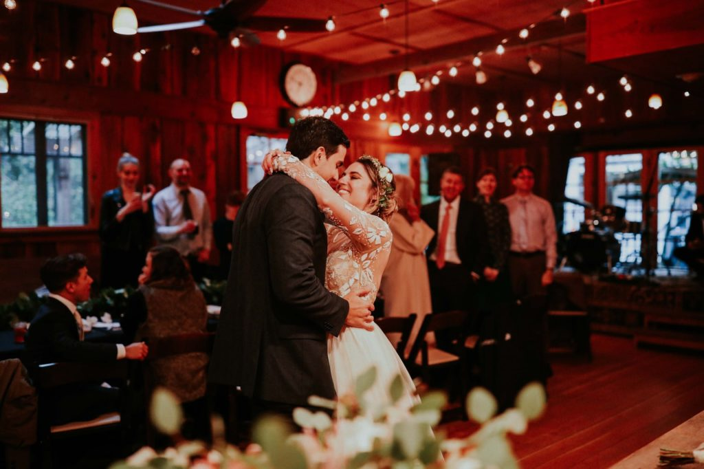 bride and groom first dance at their treehouse point wedding