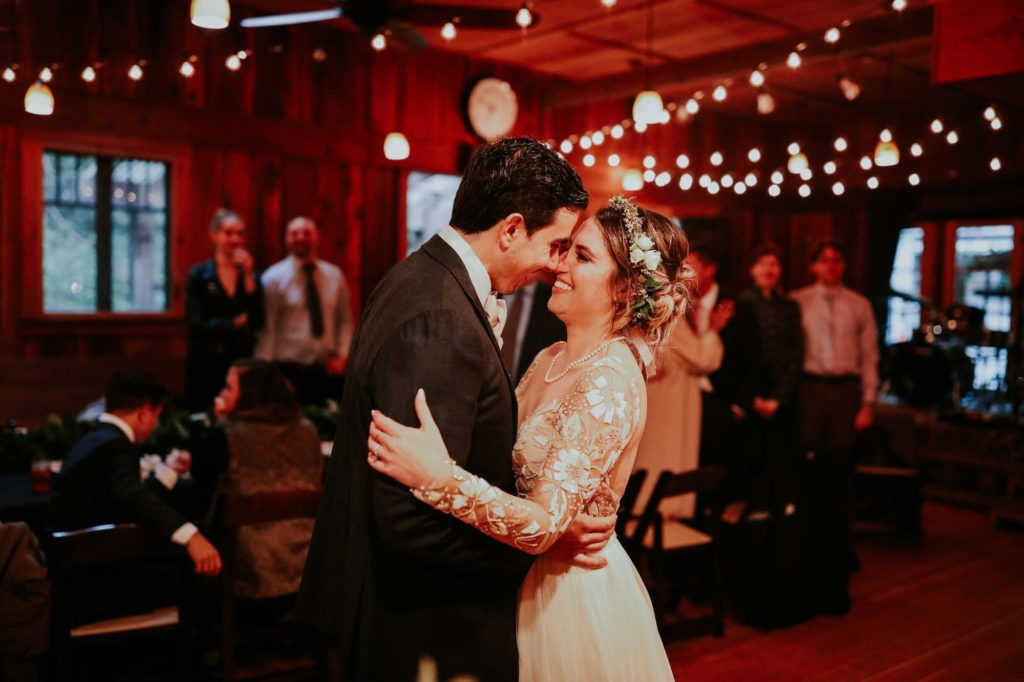 first dance at their rainy wedding day