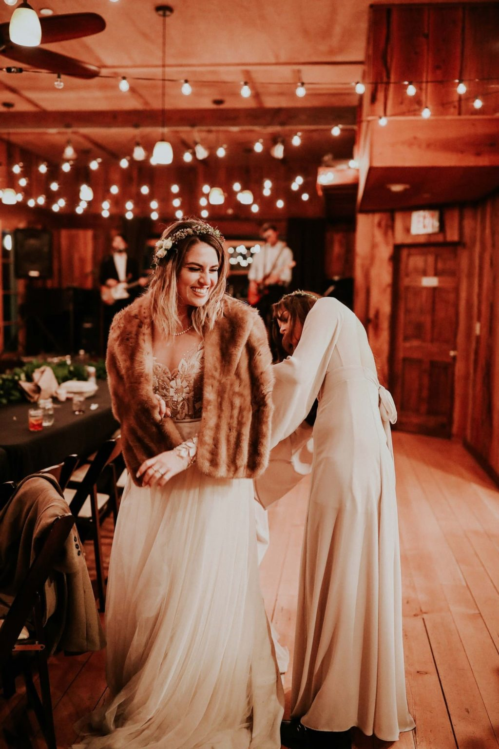 Bridesmaids bustling bride's wedding dress
