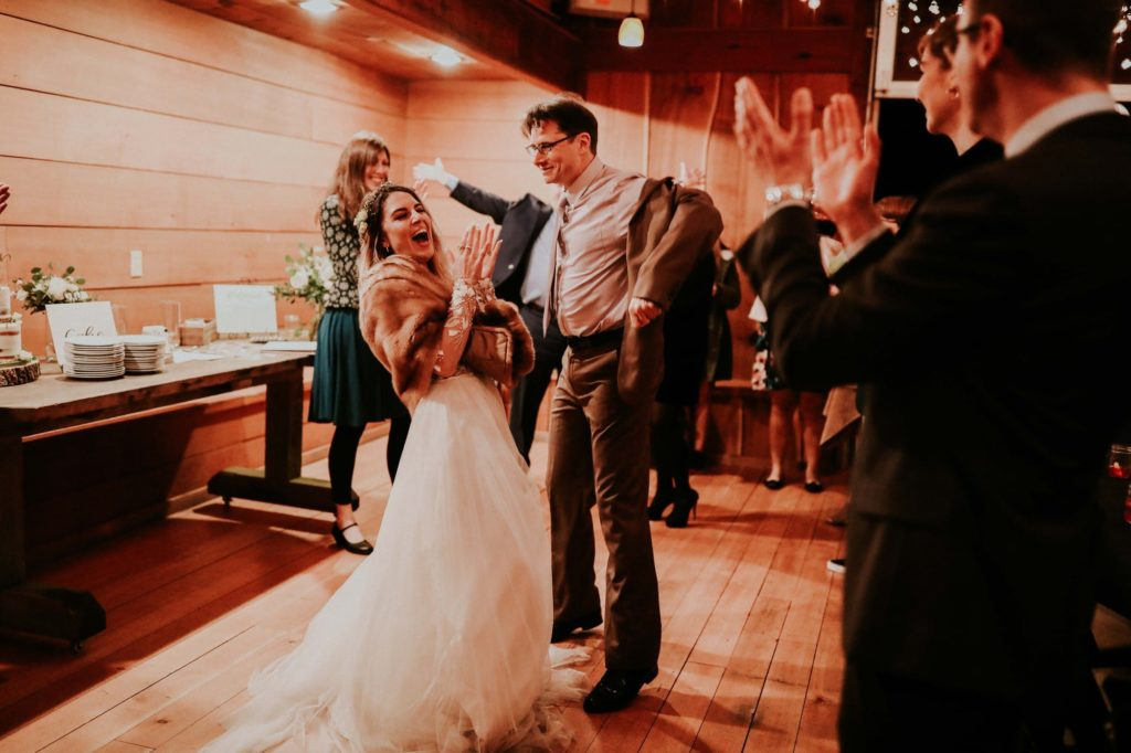 bride laughing and dancing with her dad