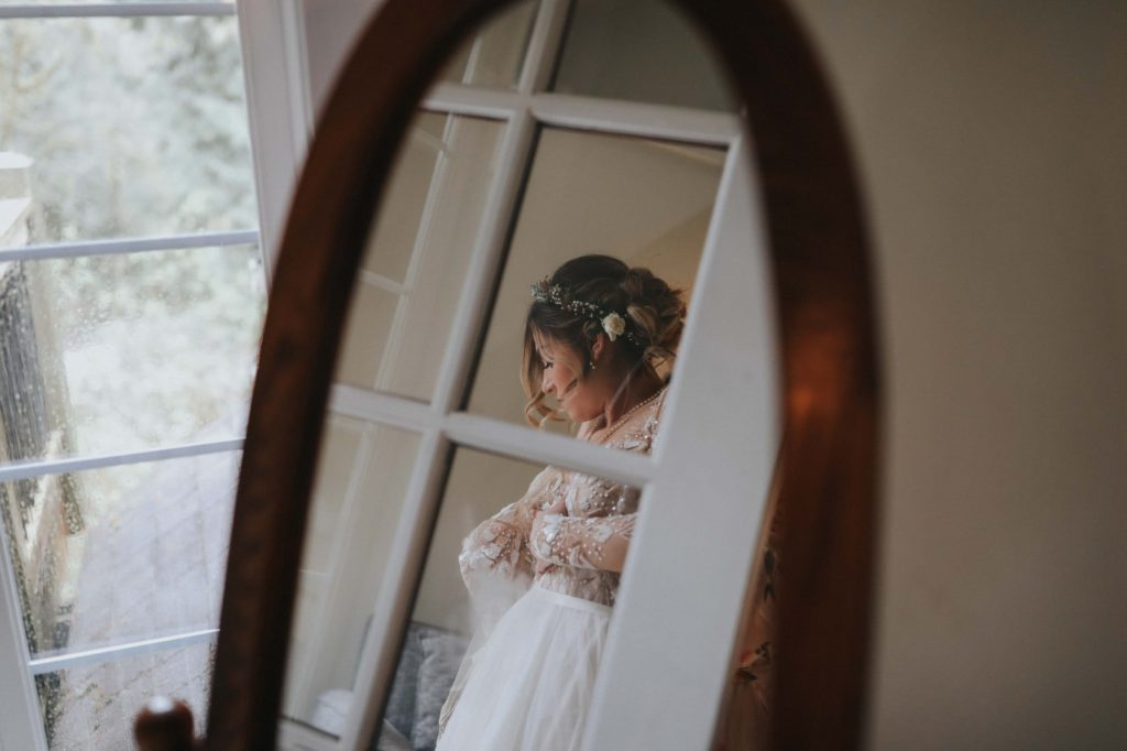 bride getting ready for her treehouse point wedding