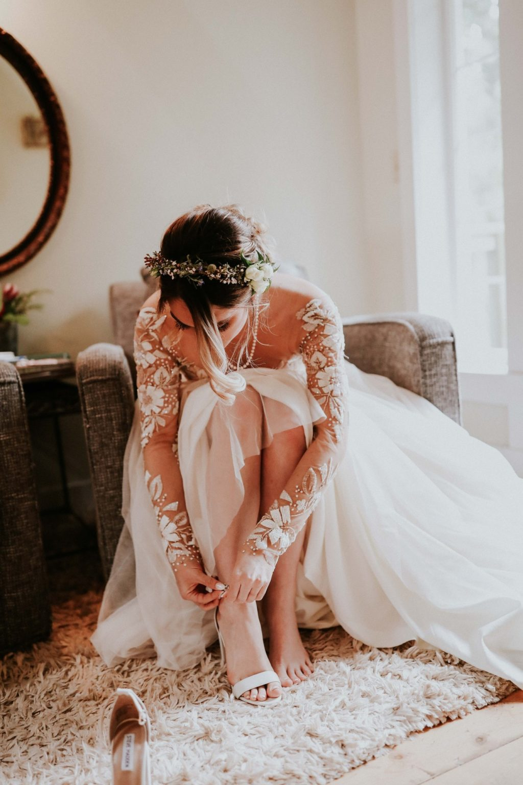 bride putting on steve madden shoes