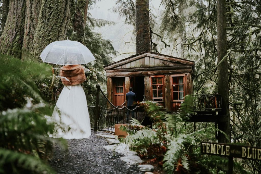 bride and groom doing their first look on their rainy wedding day