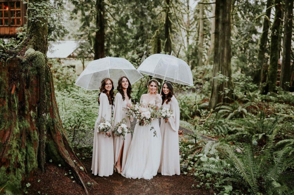 bohemian bridesmaids under umbrellas