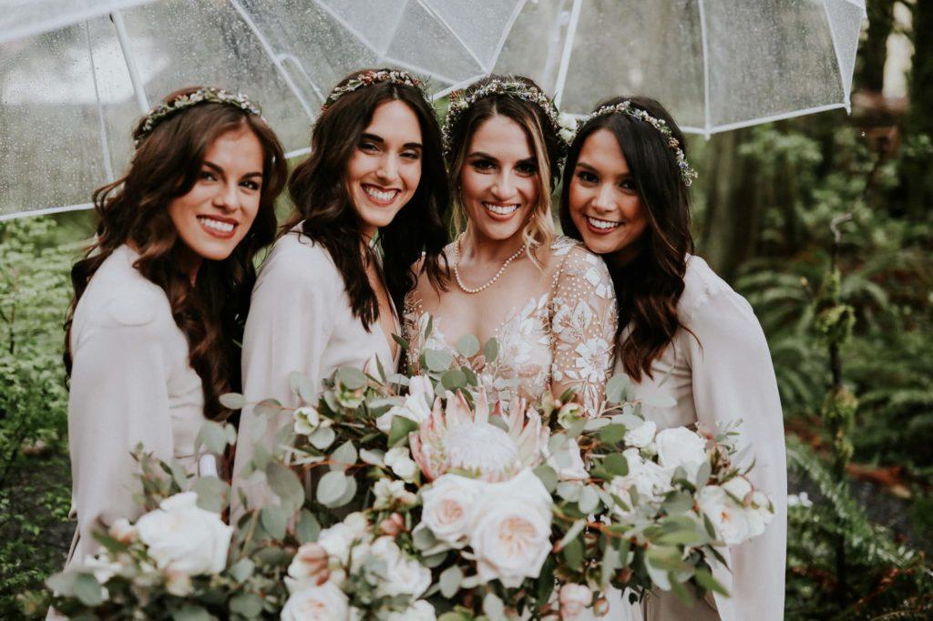 closeup of bridesmaids smiling at the camera