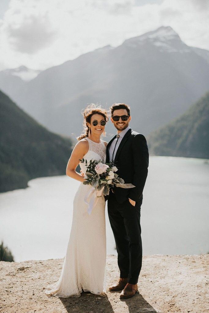 bride and groom wearing sunglasses at diablo lake
