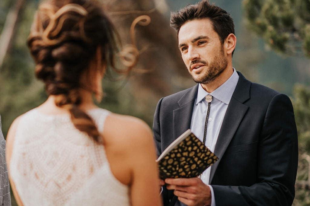 groom reaching vows to bride during diablo lake elopement